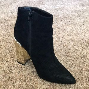 Black suede point toe ankle boots